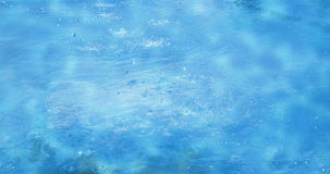 Blue sea ocean waves water drops or foutain calm movement background in sunny day with sun light on surface stock video