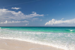 Blue sea or ocean, white sand and sky with clouds Royalty Free Stock Images