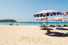 Blue sea and parasol with some people. Phuket,Thailand - March 01, 2016: Blue sea and parasol with some people relax on the white sand beach Stock Photos