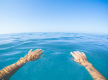 Blue sea point of view from first person Royalty Free Stock Image