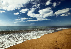 Blue sea and red sand stock photo