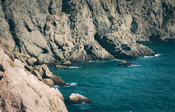 Blue Sea and rocky seaside Stock Photography