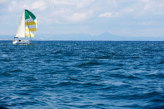 Blue sea with sailboat Stock Photo