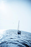 Blue sea with sailboat Royalty Free Stock Images