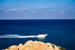 In the blue sea sailing white yacht. Cyprus Stock Image
