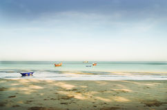 Blue sea with sand beach in morning light. Blue sea with sand beach and blue sky in morning light Stock Image