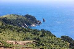 Blue sea and rocky shore Royalty Free Stock Photo