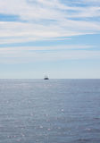 Blue sea. Ship on the horizon. Stock Photography