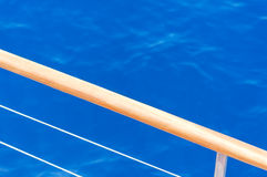 Blue sea and ship rail background Stock Image