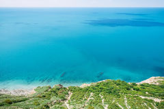 Blue sea and shore in Greece. Summer day on ocean Stock Photography