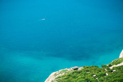 Blue sea and shore with trees. Summer day on ocean Royalty Free Stock Photos