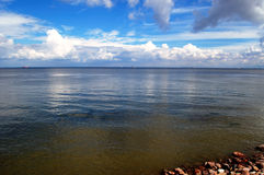 Blue sea & sky. With white clouds Royalty Free Stock Photos