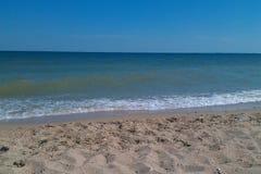 Blue sea, blue sky. A beautiful blue sea with a beach Royalty Free Stock Image