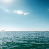 Blue sea and sky with clouds Royalty Free Stock Photo