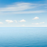 Blue sea and sky with clouds Stock Photography