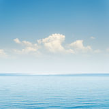 Blue sea and sky with clouds Royalty Free Stock Images