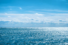 Blue sea with sky and clouds Stock Image
