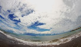 Blue sea with the sky full of clouds Royalty Free Stock Photography
