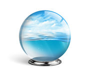 Blue sea and sky in the glass ball isolated on white background, Stock Photography
