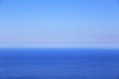Blue sea and sky horizon. Background stock image