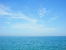Blue sea and sky horizon with clouds royalty free stock photo