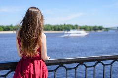 Blue sea sky life sails-man cry day dream sad dreamy lady in red royalty free stock photo