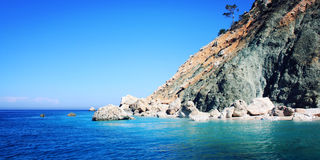 Blue sea and sky. Small island near Adrasan. Rocky shore. Royalty Free Stock Photo