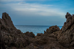 Blue sea and sky view between rocks Royalty Free Stock Photos