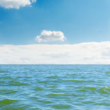 Blue sea, sky and white clouds Stock Photography