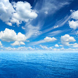 Blue sea and sky, white clouds, sunny weather. Peaceful background - blue sea and sky, white clouds, sunny weather stock photos