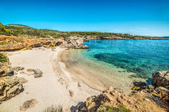 Blue sea in a small cove in Sardinia Stock Photography