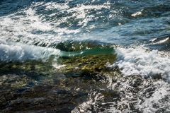 Crystal clear soft wave in Malta royalty free stock photo