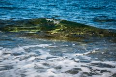 Crystal clear soft wave in Malta Gozo stock photography