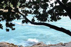 The blue sea and a stone wall. royalty free stock images