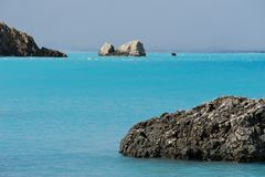 Blue sea, stones, horizon, beach. Seascape of the blue sea coast of the Ioannic Sea in Greece. Laconism and beauty of the Greek prophets. Sea and rocks. Tropical royalty free stock image