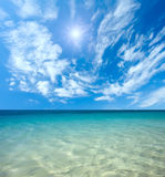 Blue sea and sun in the sky. With clouds Stock Image
