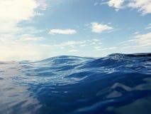 Blue sea and sun on sky. Blue sea Stock Photos