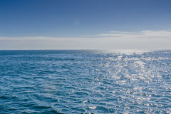 Blue sea with sunlight reflected on it Stock Photo