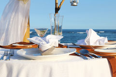 Blue sea and a table for a romantic dinner on the beac Stock Images