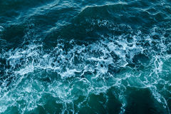 Blue sea texture texture with waves and foam Royalty Free Stock Image
