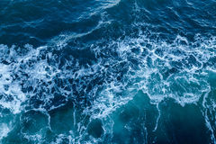 Blue sea texture with waves and foam Royalty Free Stock Photos