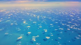 Blue sea with tiny clouds stock photography