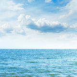 Blue sea to horizon and clouds Royalty Free Stock Image