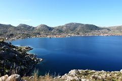 Blue sea view, Selimiye, Turkey, Aegean Sea. Selimiye village`s view with blue sea. Blue water bay in Aegean. Blue bay with a small village royalty free stock photography