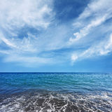 Blue sea water and beautiful clouds Royalty Free Stock Image
