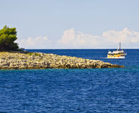 Blue sea water, boat and island Royalty Free Stock Photos