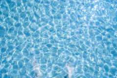 Blue sea water and  feet in water, background, Royalty Free Stock Photos