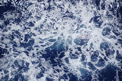 Blue Sea Water with Foam Stock Photo