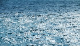 Blue sea water surface, natural background. Photo texture royalty free stock photo