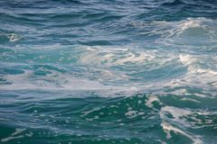 Blue sea water with waves. And foam Royalty Free Stock Photo